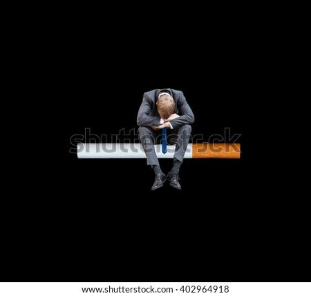 A sad smoker - stock photo