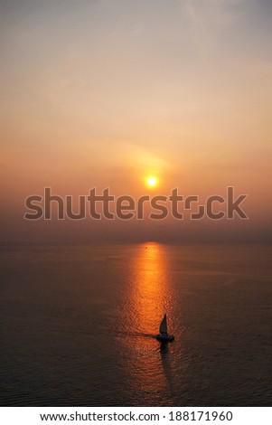 A sailboat at sunset,Phuket,Thailand - stock photo