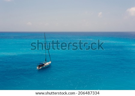 A sailboat on the Ionian sea, in Greece - stock photo