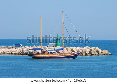 A sailing ship as it leaves the Port of Trani in Apulia - Italy