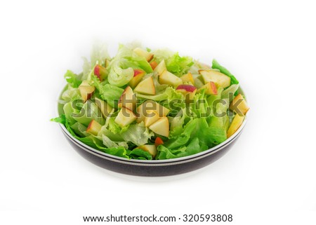 A salad is a dish consisting of small pieces of food, which may be mixed sauce or salad dressing. Salads can incorporate a variety of foods including vegetables, fruits, cheese, cooked meat, eggs. - stock photo