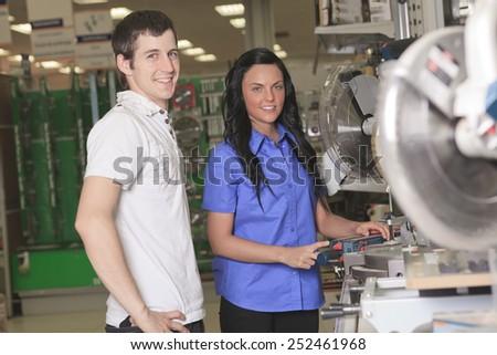A sales assistant portrait in home appliance shop supermarket store - stock photo