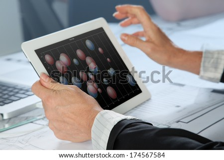 A Sales woman is analyzing a bubble chart. - stock photo