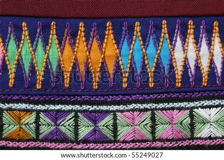 A sample of woven ethnic cloth fabric taken in close up. Fabric is woven by a minority tribe living in the mountainous regions of Thailand and China. - stock photo