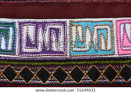A sample of woven ethnic cloth fabric taken in close up. Fabric is woven by a minority tribe living in the mountainous regions of Thailand and China