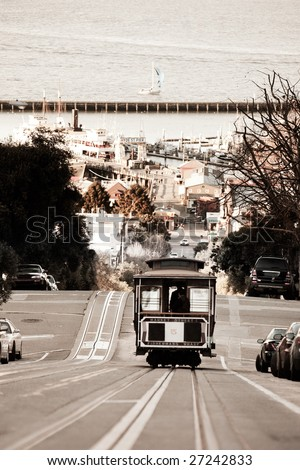 A San Francisco cable car desending down Hyde Street - stock photo