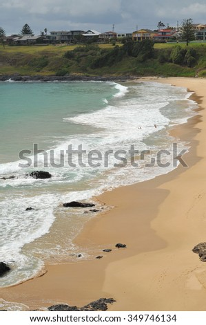 A sand and rock beach in Kiama. - stock photo