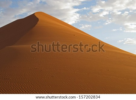 A sand dune at Sossusvlei Namibia. rising to more than 300 meters they are the tallest in the world.