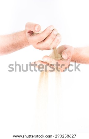 A sand in the hands. Isolated on a white background