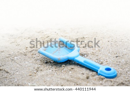 A sand toy is on the beach.