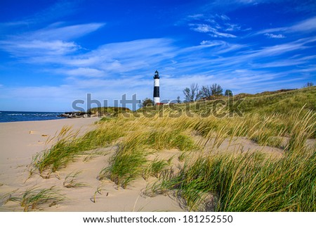 A Sandy Beach And Beach Grass At The Big Sable Point Lighthouse On Lake Michigan, Michigan's Lower Peninsula, USA - stock photo