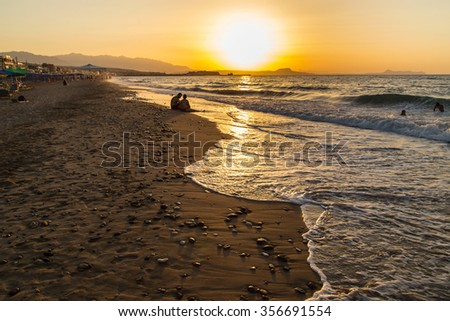 A sandy beach in Greece, on a hot day