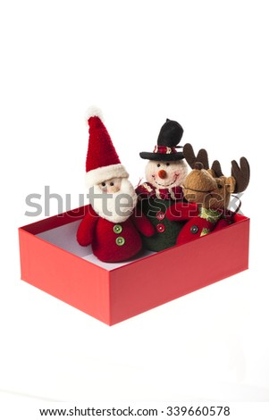 A santa, snowman, Rudolph deer dolls in a opened red box for christmas(xmas) isolated white. - stock photo