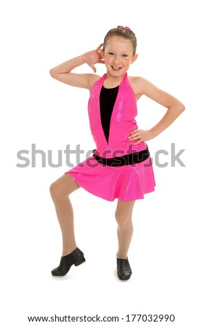 A Sassy Young Tap Dancing Kid Poses in Pink Outfit