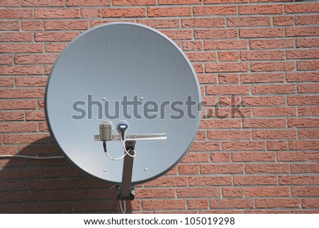 A satelite is attached to the wall - stock photo