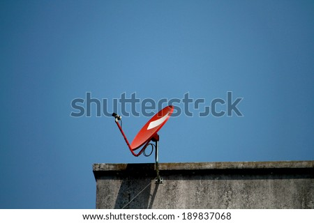 A satellite dishon the roof - stock photo