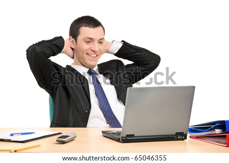 A satisfied businessman looking at his laptop isolated on white background