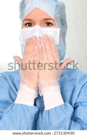 A Scared female Physician with Hands on mouth OP - stock photo