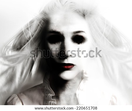 A scary evil woman with black eyes and red lips is death on a white background for a fear or Halloween concept. - stock photo