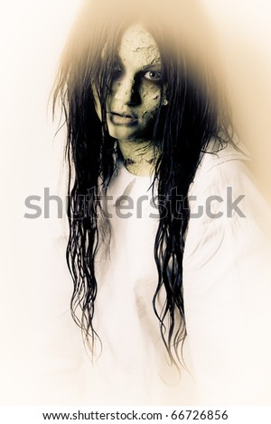 a scary ghost girl wearing a white nightie