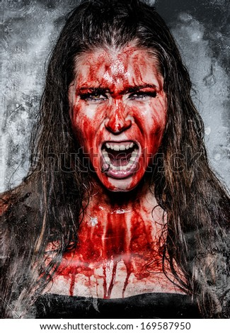 a scary horror girl covered in blood - stock photo
