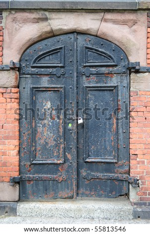 A scary looking door with a pad lock in New York City. - stock photo