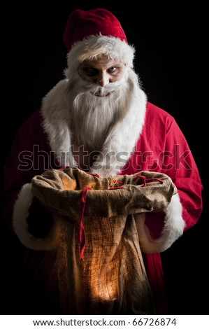 a scary looking santa holding  a glowing present bag