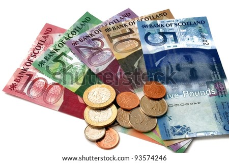 A scatter of Scottish banknotes and sterling coins. - stock photo