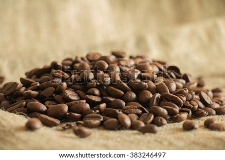 a scattering of coffee beans on burlap