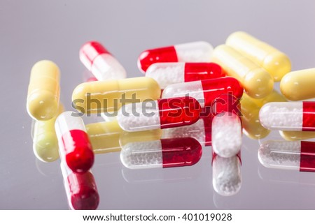 a scattering of colored capsules and tablets, close-up, photograph with depth of field