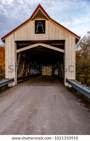 A scenic, autumn view of the Mechanicsville covered Howe through truss bridge in Ashtabula County, Ohio.