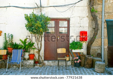 A scenic doorway to an ancient home in Portugal village. - stock photo
