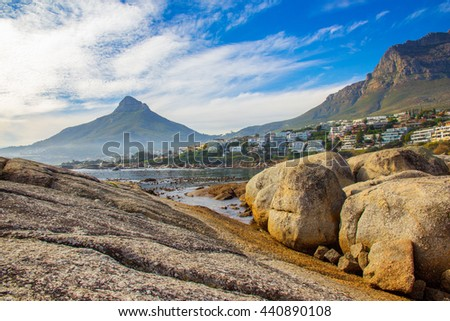 A scenic landscape of the beautiful coast of Bakoven in Cape Town, South Africa with Lion's Head as the backdrop - stock photo