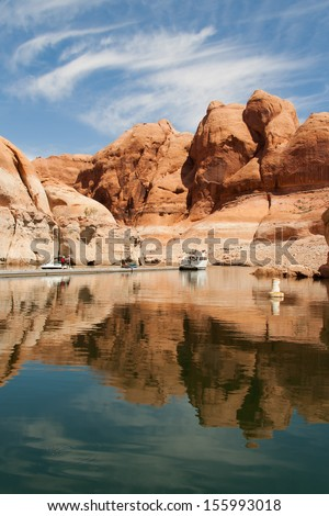 A scenic landscape view of a recreational area in Lake Powell where you can get a water boat tour - stock photo