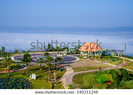 A scenic pavilion with a beautiful garden in the sea mist, top of reclamation field, Mae Moh mine, Lampang, Thailand. - stock photo