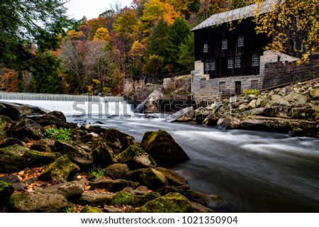 A scenic view of the historic McConnell`s Mill and waterfall during an autumn afternoon at McConnell`s Mill State Park in western Pennsylvania.