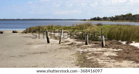 A scenic  view of the    Leschenault Estuary   conservation park near Australind Western Australia on a calm day in summer as the tide is receding is peaceful and relaxing.