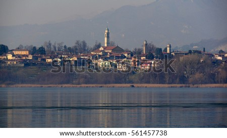a scenic view of the village of Annone on lake Oggiono,  a beautiful mere close to lake Como, Lombardy, Italy.