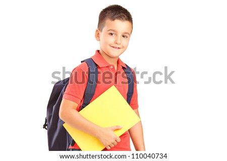 A school boy with backpack holding a notebook isolated against white