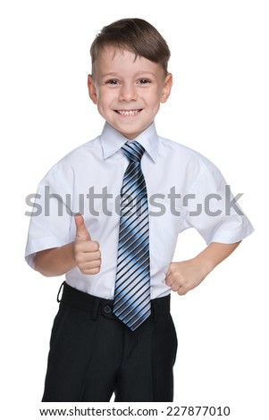 A schoolboy with his thumb up on the white background - stock photo