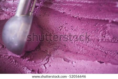A scoop of blueberry ice cream - stock photo