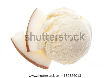 A scoop of coconut ice cream with slices of coconut from bird's eye view