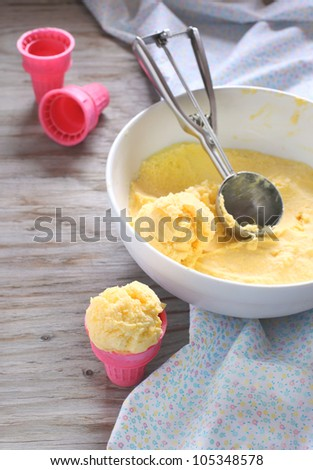 A scoop of mango ice cream - stock photo