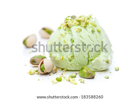 A scoop of pistachio ice cream with pistachios isolated on white background - stock photo