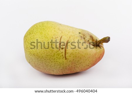 a scratched pear white isolated, closeup
