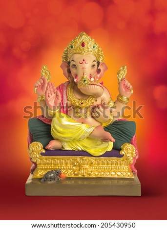 A sculpture of an Indian god Lord Ganesha on bright red background - stock photo