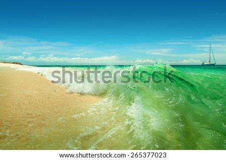A sea landscape with turquoise waves and yacht
