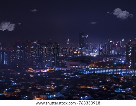 A sea of lights in the city: aerial night view of Petaling Jaya leading to Kuala Lumpur and the Petronas towers