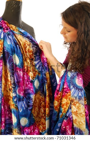 A seamstress create a new dress