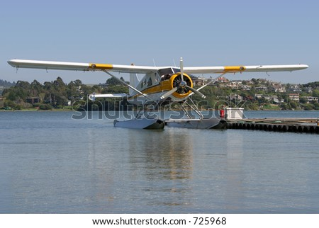 A seaplane floats on standby.